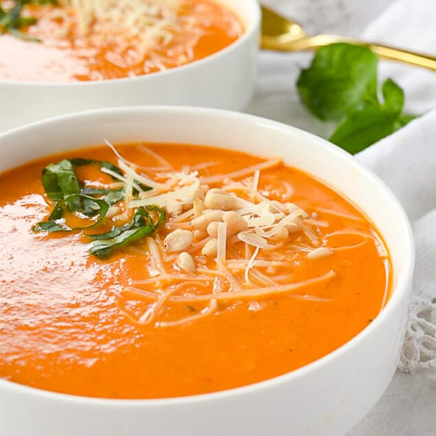two bowls of tomato soup