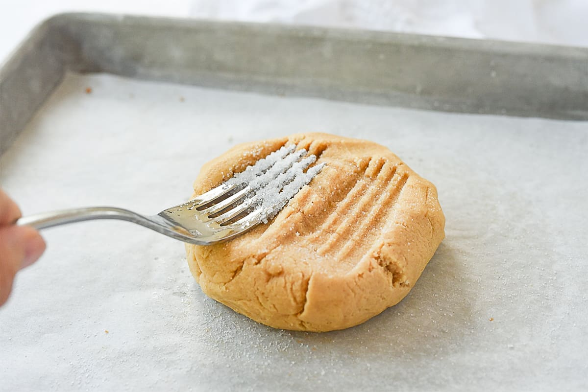 fork pressing into cookie