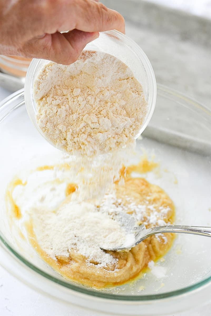 adding flour to snickerdoodle dough