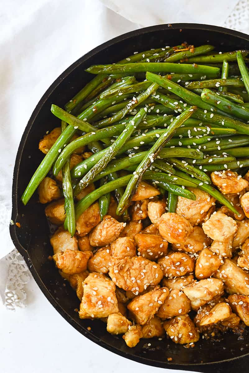 ovehead shot of pan full of chicken and green beans