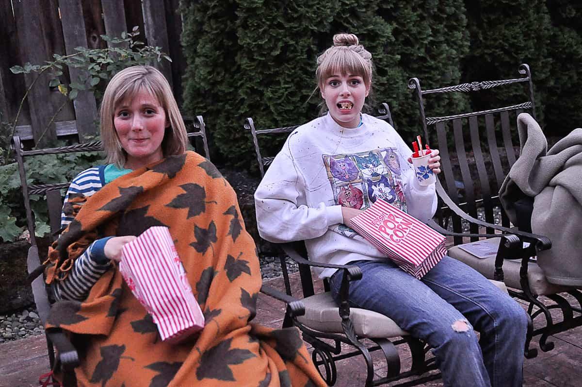 girls eating popcorn