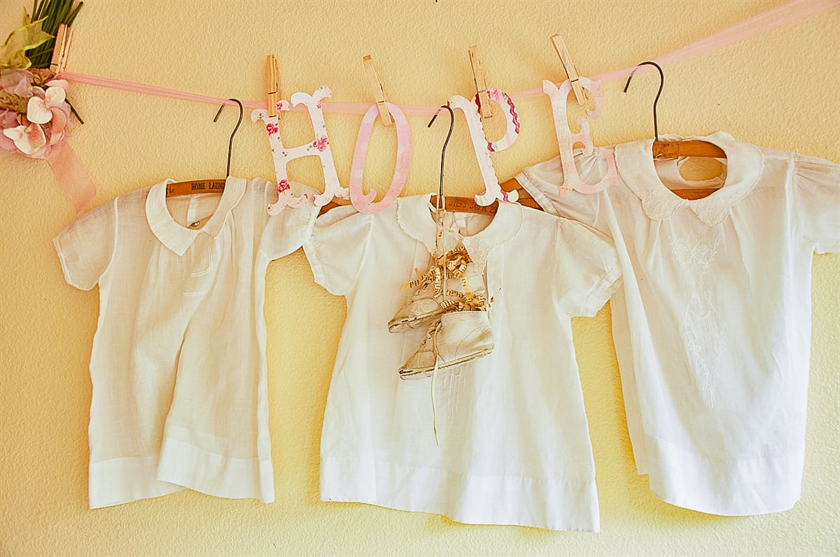 vintage baby dressing hanging on wall