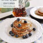 pancakes on a plate with blueberries on top