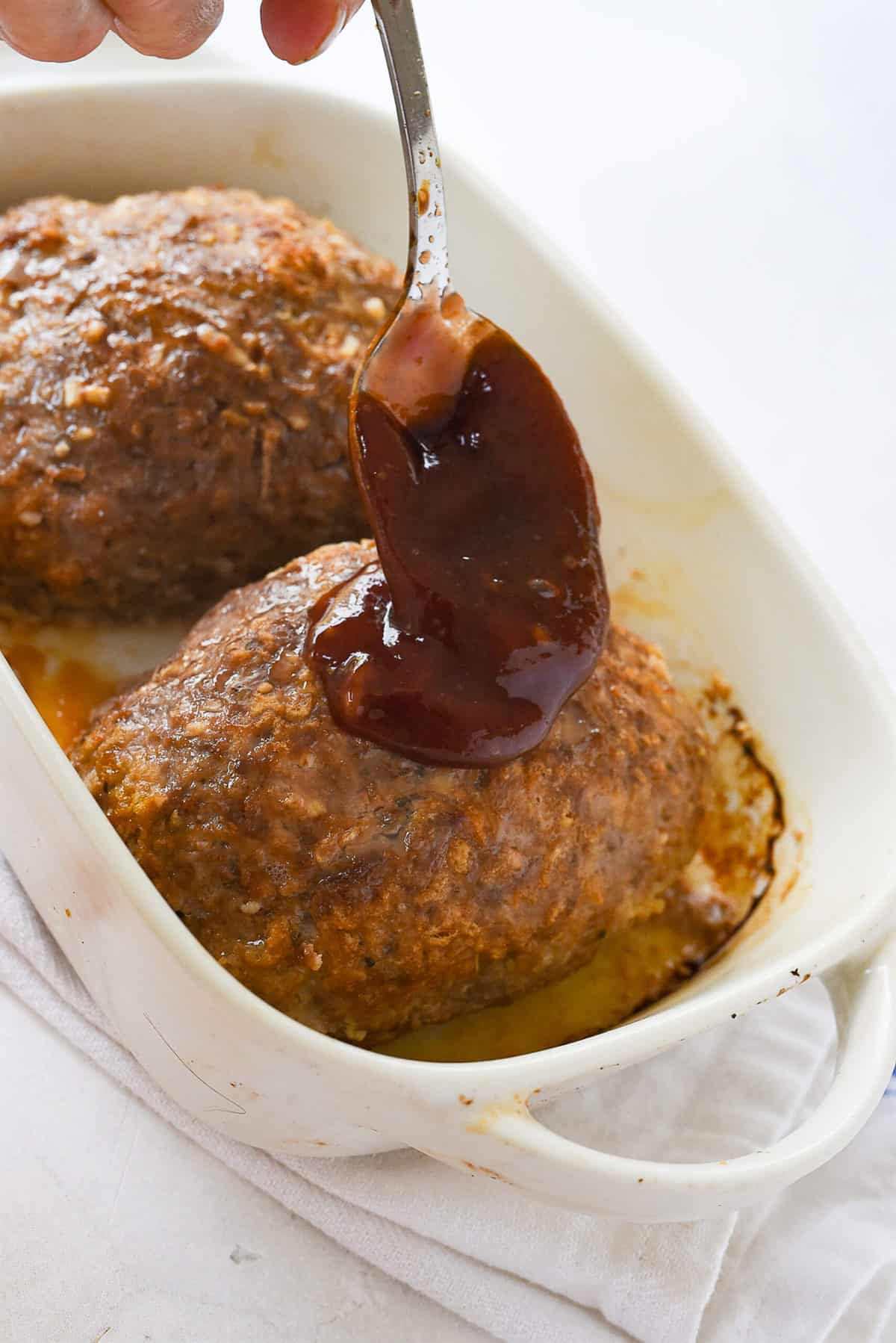 glazing the meatloaf with ketchup mixture