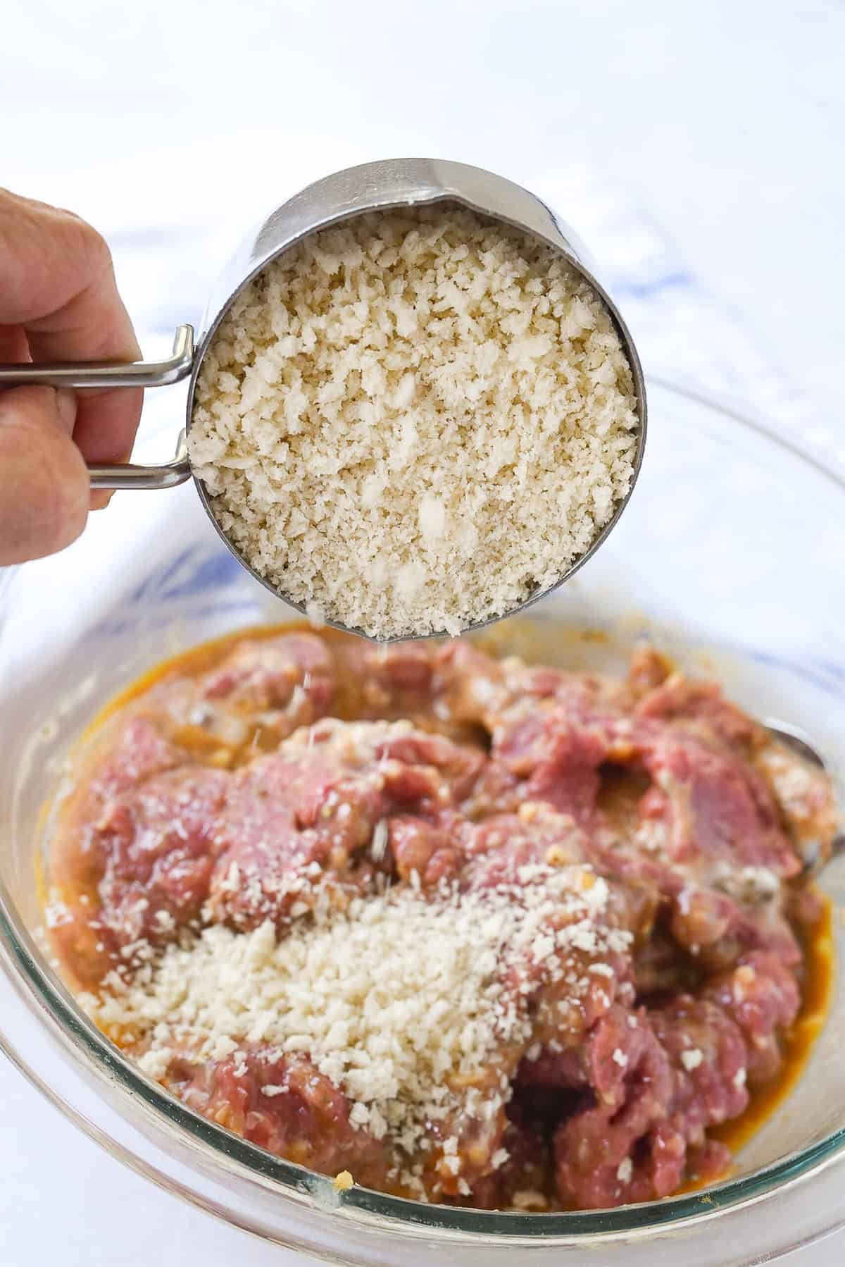 adding breadcrumbs to mini meatloaf