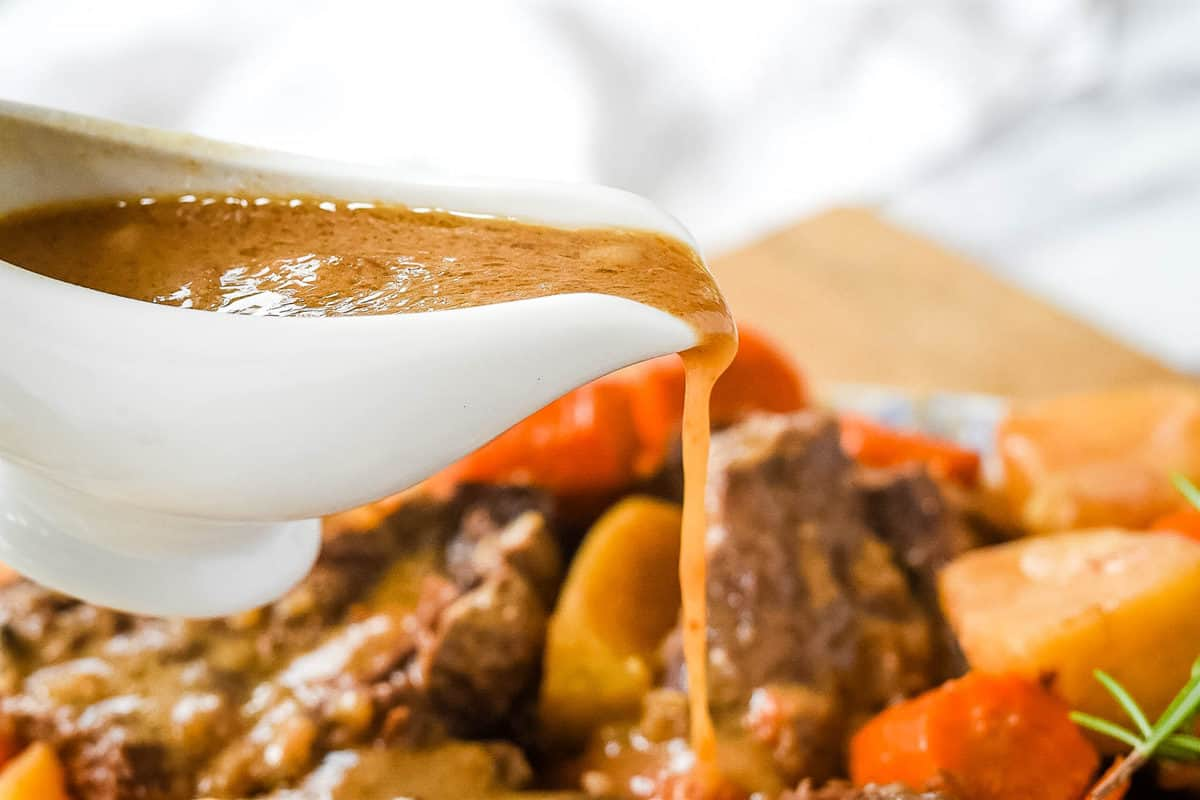 Pouring gravy on pot roast