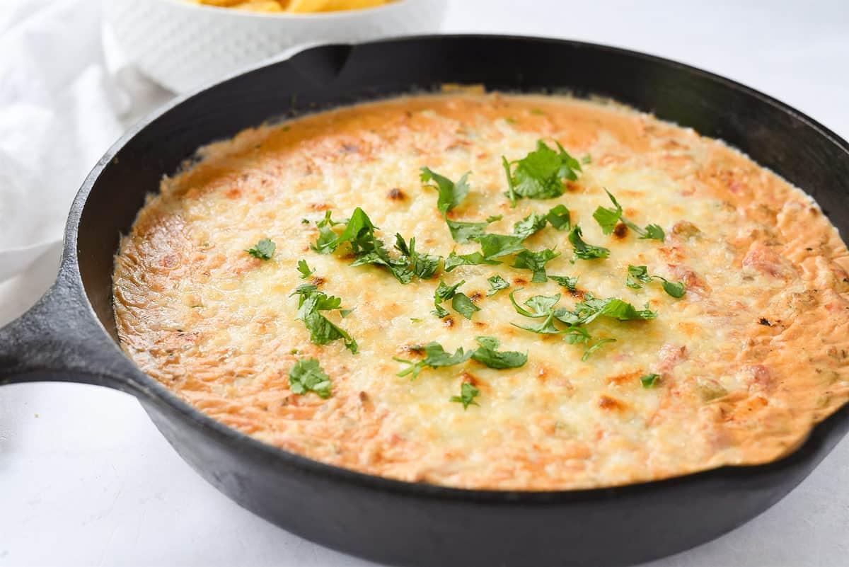 cast iron skillet of chili con queso dip