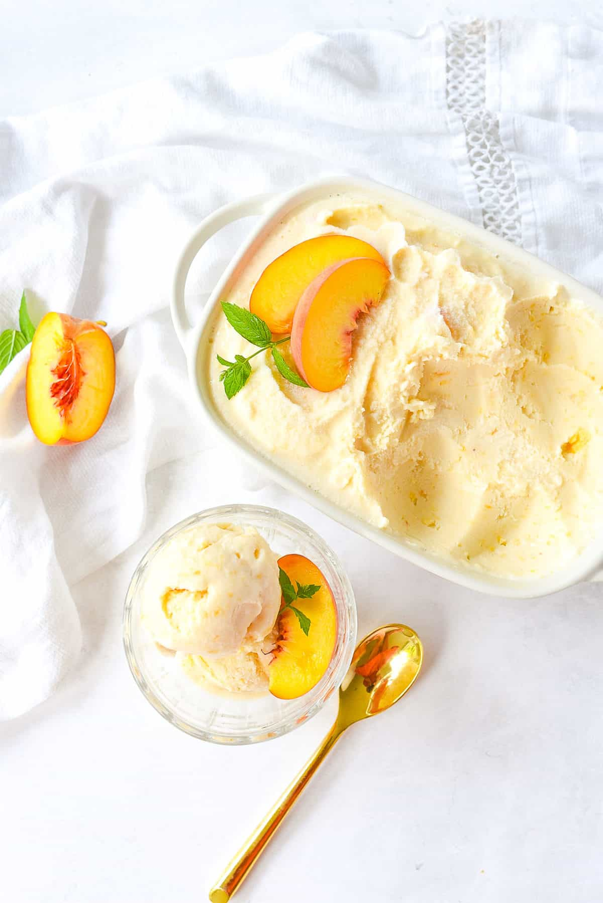 dish of peach ice cream and a spoon