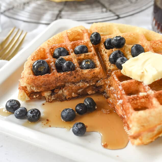 waffles with blueberries and syrup