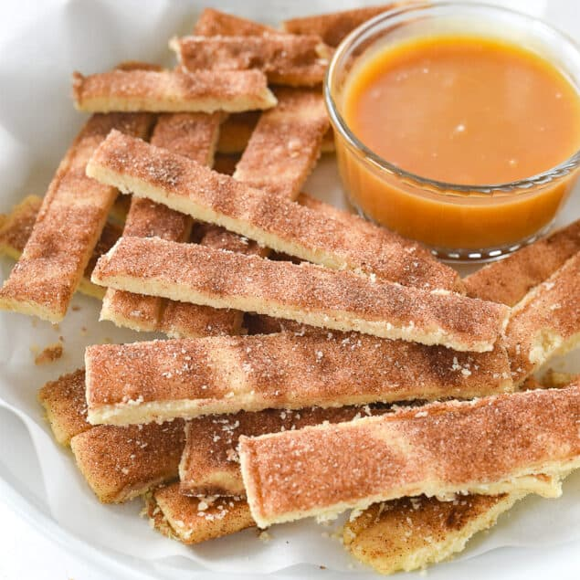 pie fries with caramel dipping sauce in a bowl