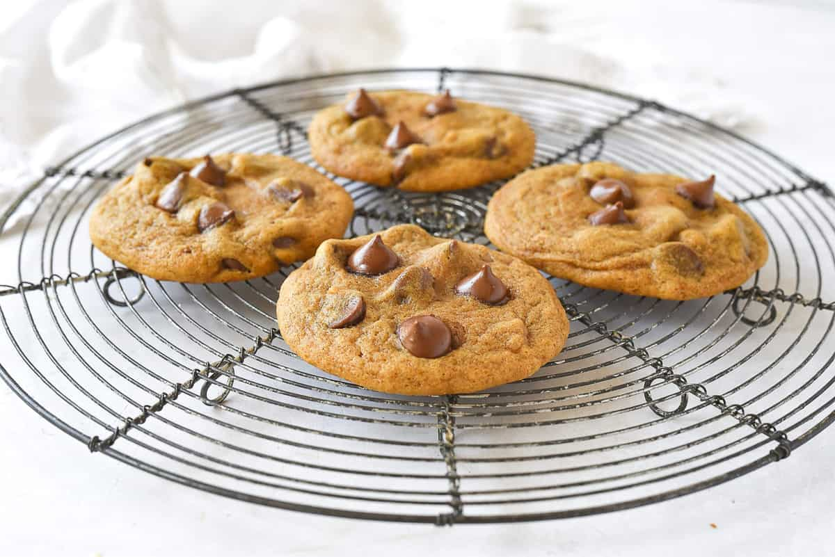 four pumpkin cookies with chocolate chips