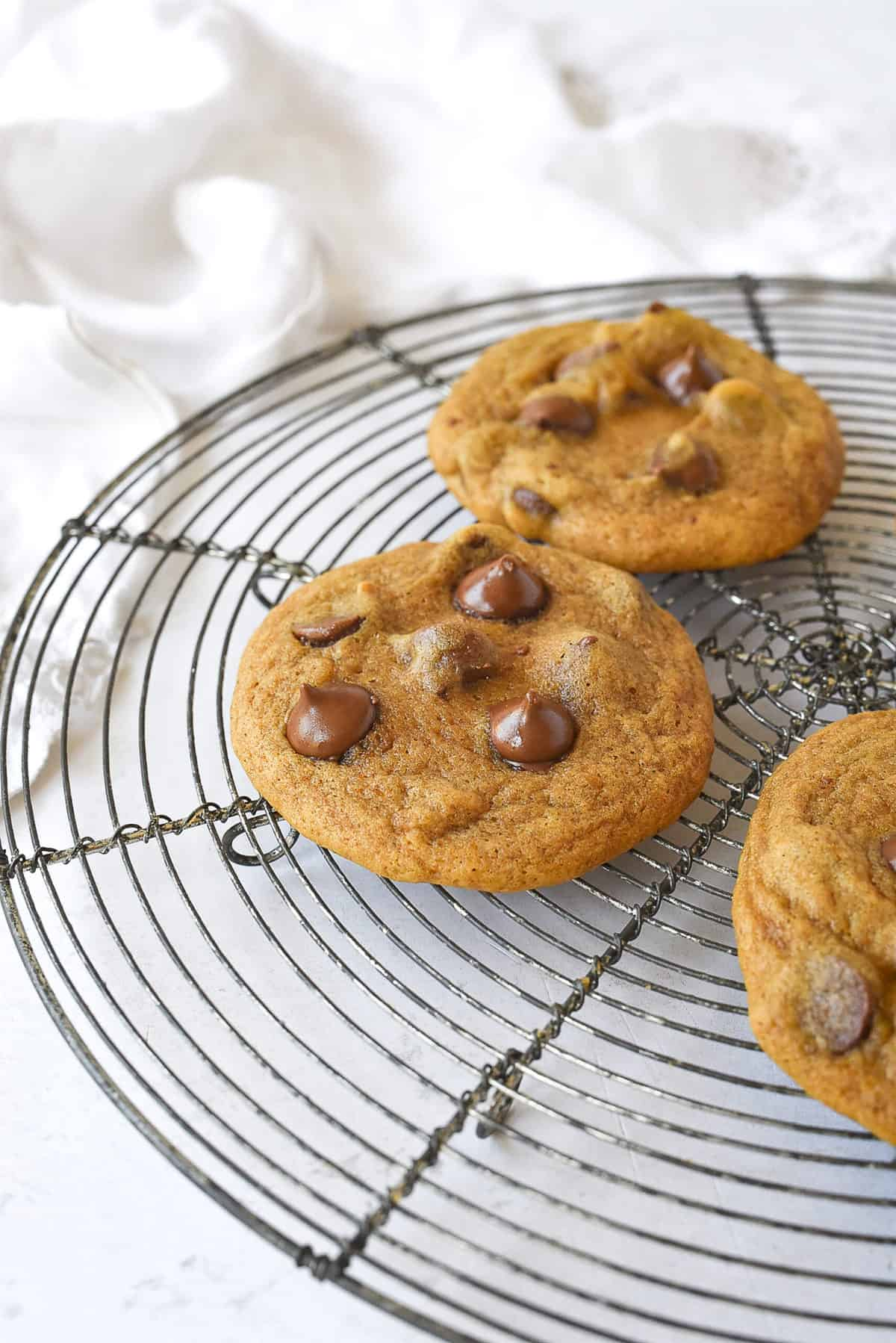 chocolate chip pumpkin cookies on cooling rack