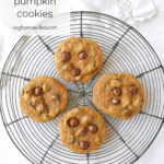 four pumpkin cookies on a cooling rack